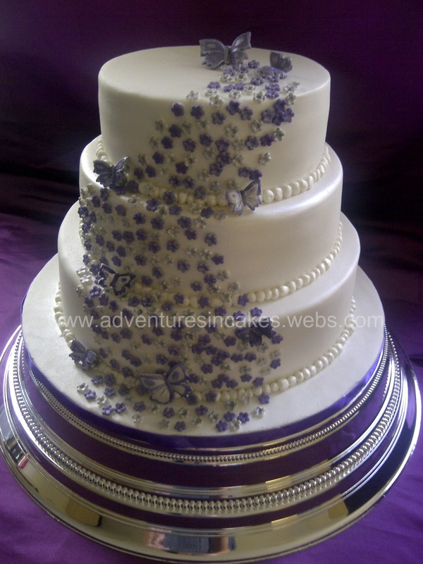 Purple And Silver Wedding Cake With Flowers