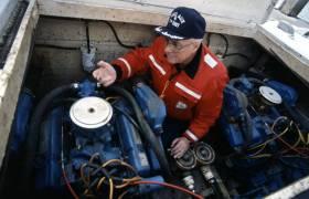 A vessel examiner checks the engine compartment.