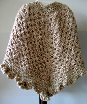 Easy Beginner Knit Poncho Pattern from SweaterBabe.com.