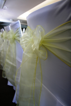 Aston Hall chair covers with lemon sashes