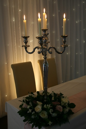 Candelabra dressed with flowers