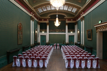 Cutlers Hall Sheffield wedding chair covers with claret organza sashes