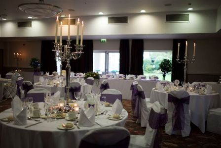 cadbury purple oganza sashes and grand silver candelabras