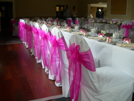 Sitwell Arms wedding chair covers with hot pink sashes