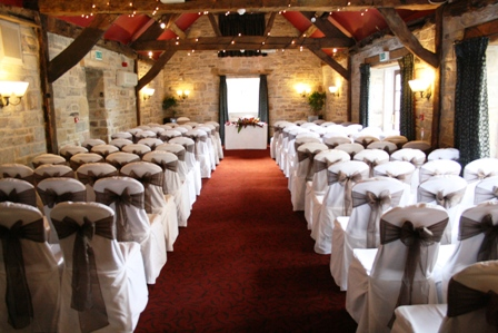 Tankersley Manor chair covers with brown organza sash