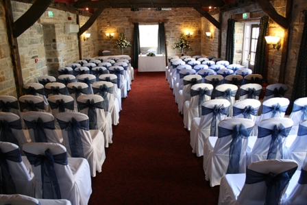 White Chair Covers With Navy Blue Oganza Sashes Dressed For A Wedding Civil