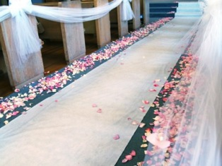 White carpet with rose petals