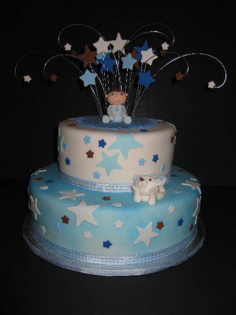 12 vanilla cake with raspberry filling covered in blue and white
